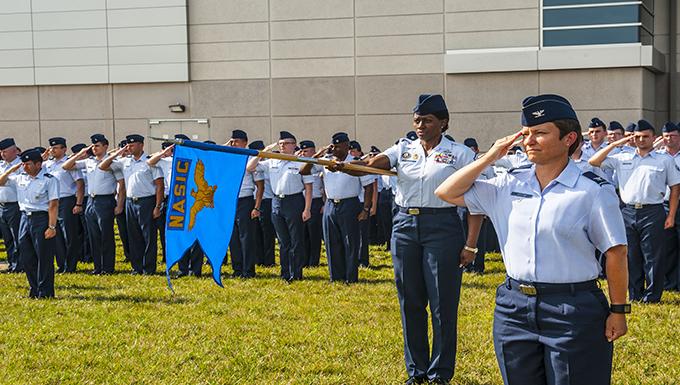 NASIC Airmen show respect to the flag